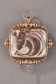 Clé de montre en or,cristal et demi-perles. XIXème siècle.