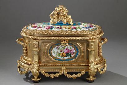 Louis XVI style Gilt bronze casket and porcelain plates. Circa 1850-1870.