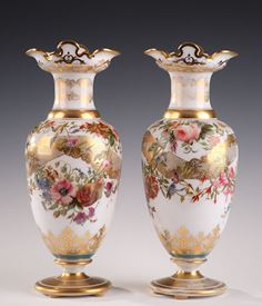 A pair of white opaline.