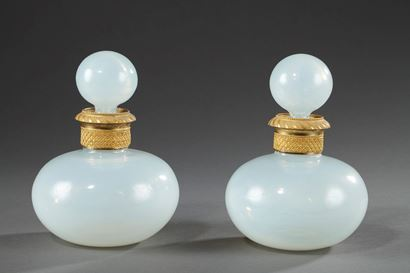 Pair of Charles X white Opaline perfume bottles.