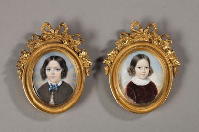 Pair of miniature on ivory. Gilt bronze frame. <br/>