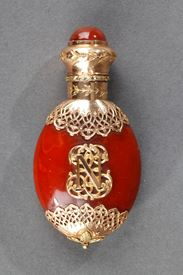 A 19th century Amber and gold scent bottle.