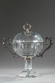 A mid-19th century confiturier in crystal and silver.