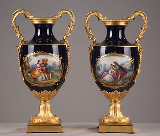 End of 19th century pair of gilt bronze and porcelain vases.