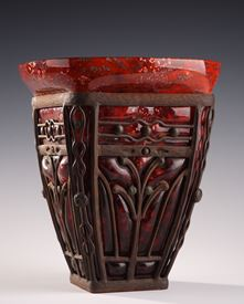 A LARGE DAUM AND MAJORELLE GLASS AND WROUGHT-IRON VASE.