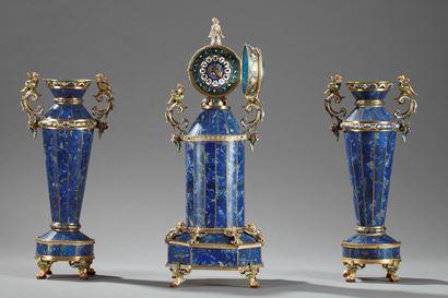 A three-piece Austrian silver-gilt, enamel and lapis lazuli clock garniture,<br/> Hermann Boehm, Vienna, circa 1880.<br/>