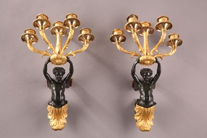 Empire sconces in patinated bronze.