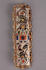 Gold and enamel belt buckle.