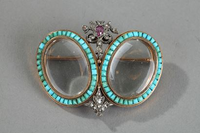 Gold, turquoise, diamonds and rubies brooche.