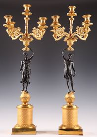 PAIR CANDELABRAs IN GILDED AND PATINATED BRONZE.