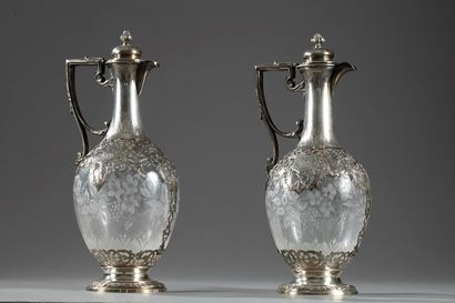 Pair of Silver and Crystal Ewers with Floral Decoration.