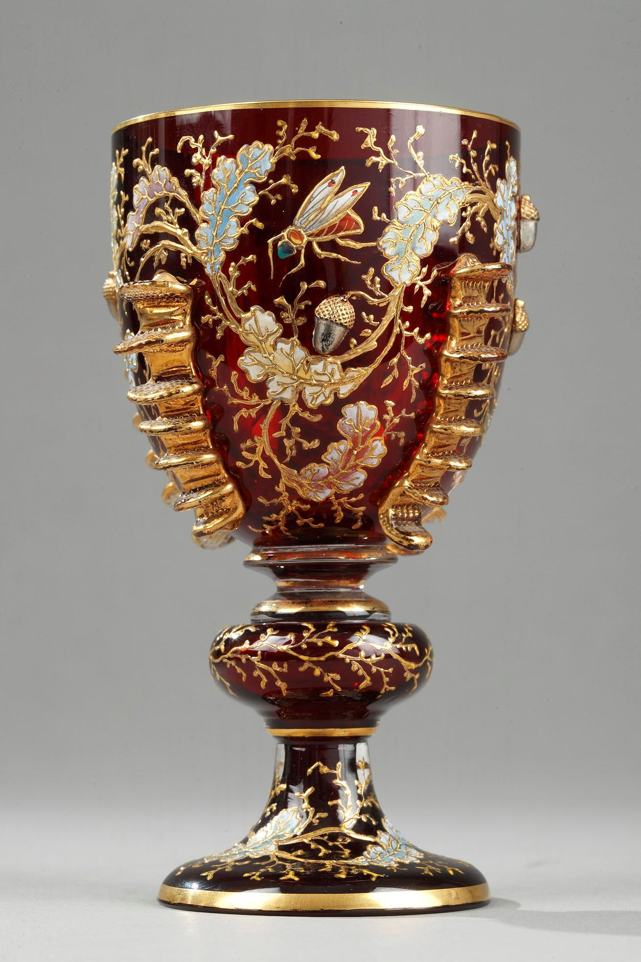 An EARLY  vase with ENAMEL AND GILT DECORATION , HIGH-RELIEF DÉCOR OF MOSER.