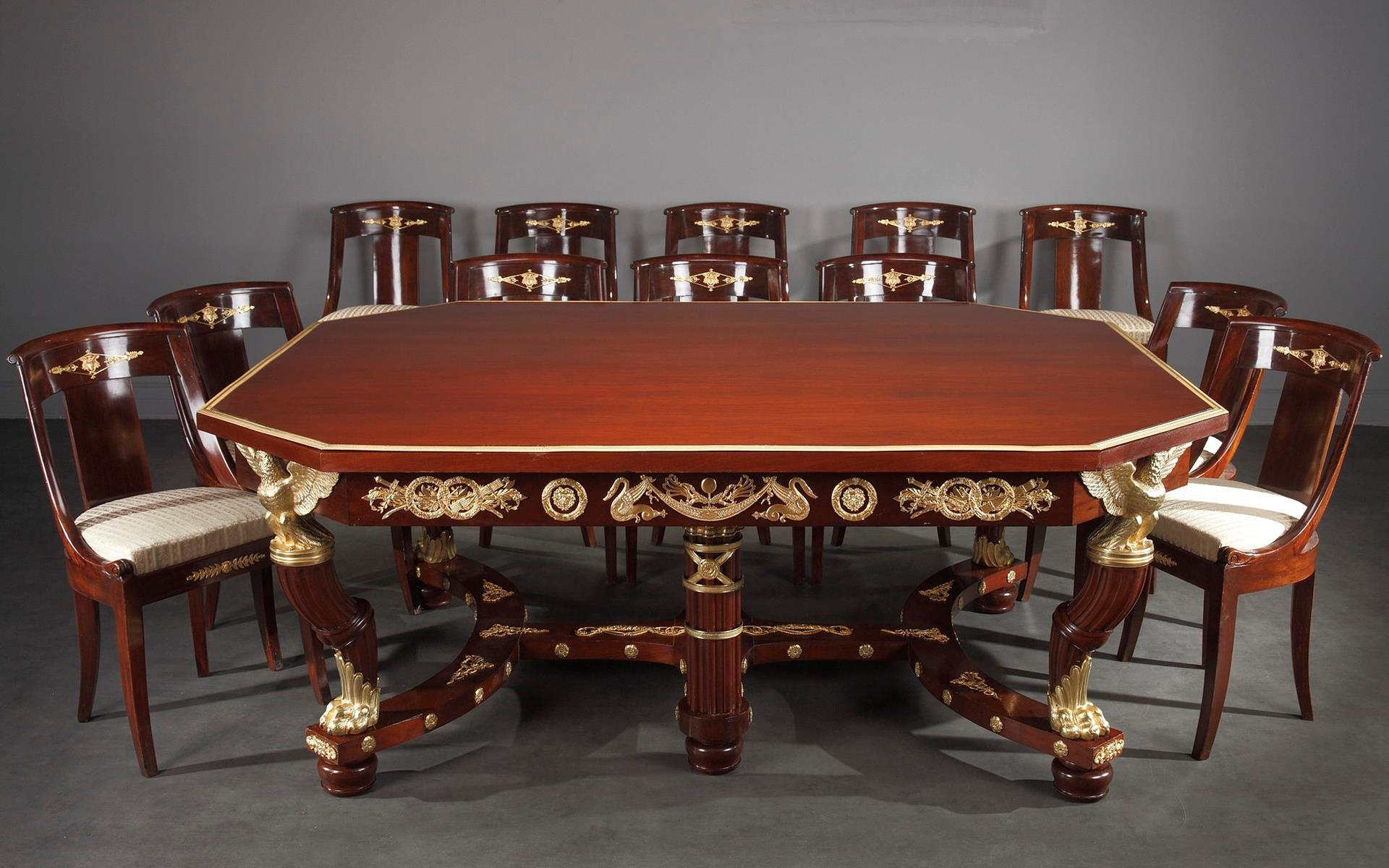 ASTONISHING MAHOGANY AND GILT BRONZE SUITE. EMPIRE STYLE
