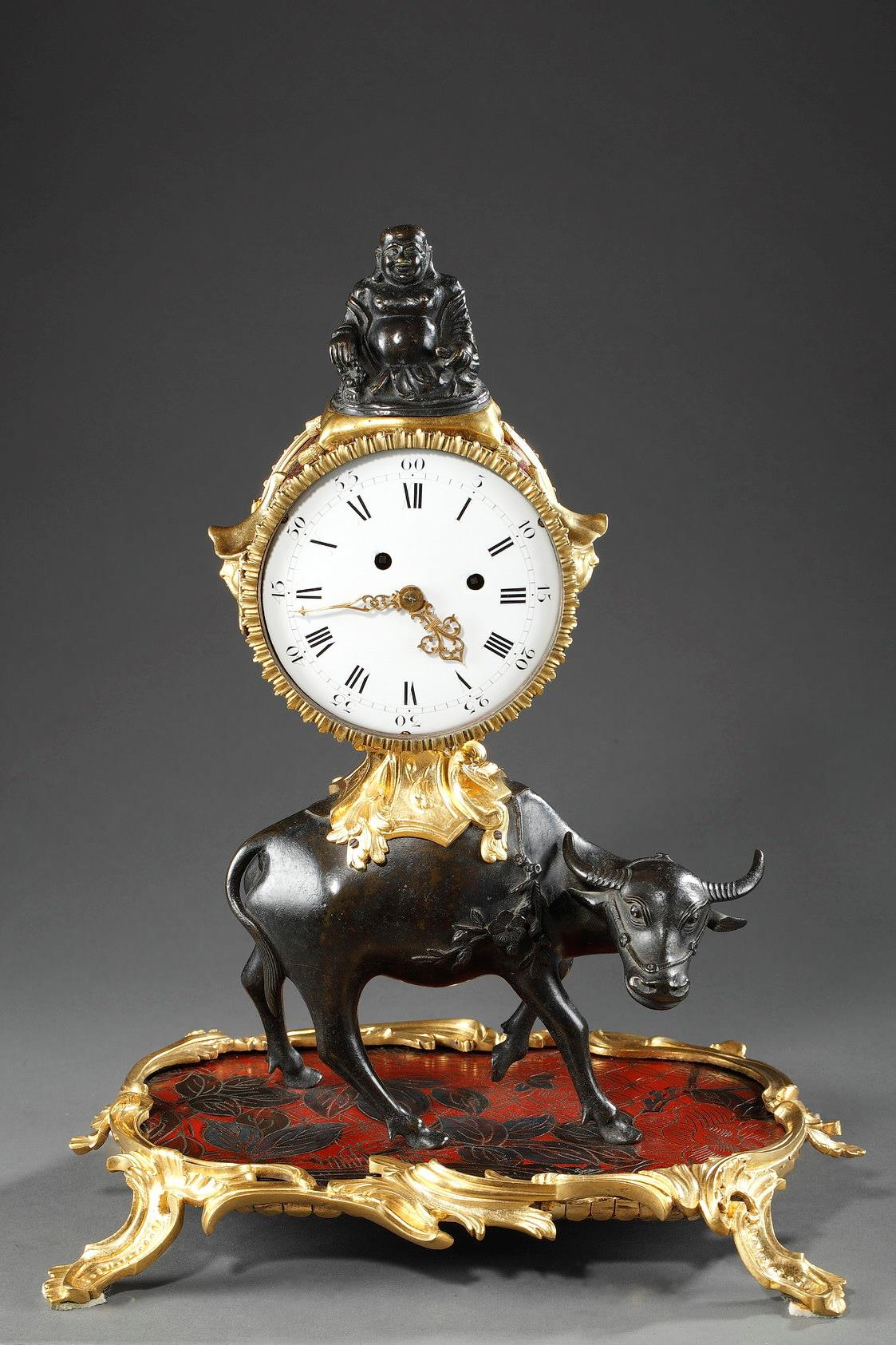 "A mid-18th century patinated and ormulu ""Chinoiserie""mantel-clock."