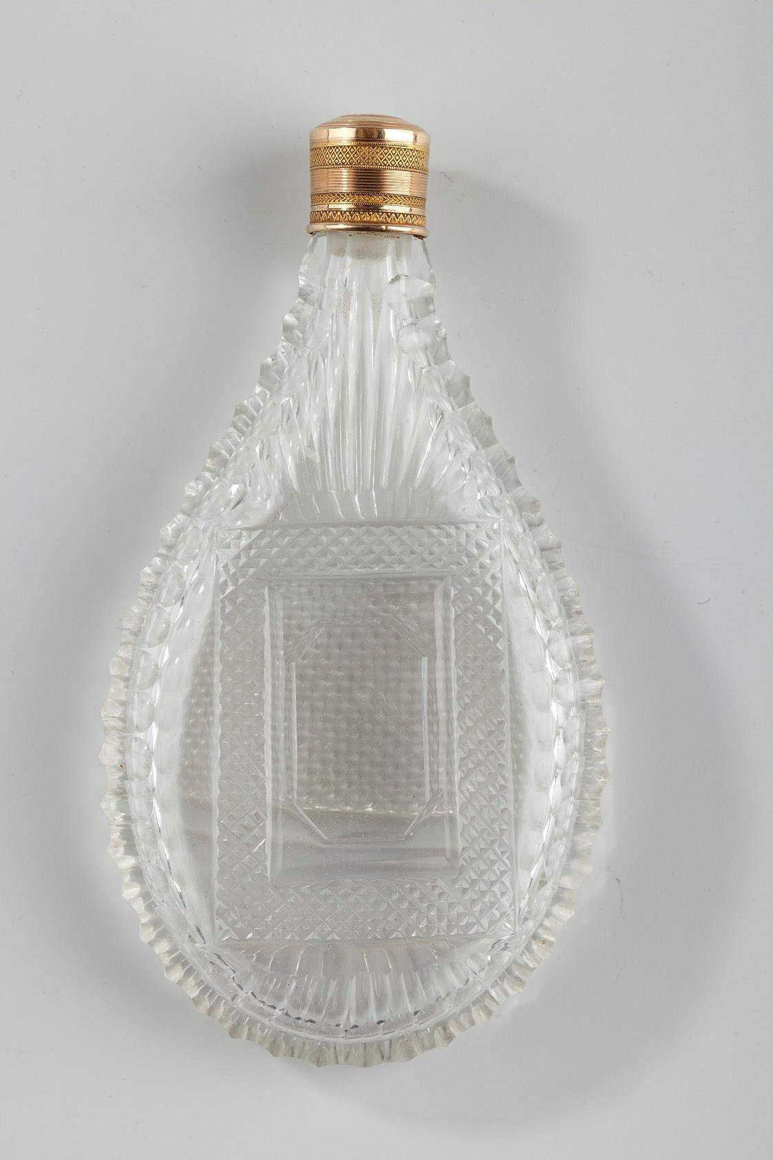 Perfume Flask in Cut Crystal with gold stopper. Mid-19th Century.