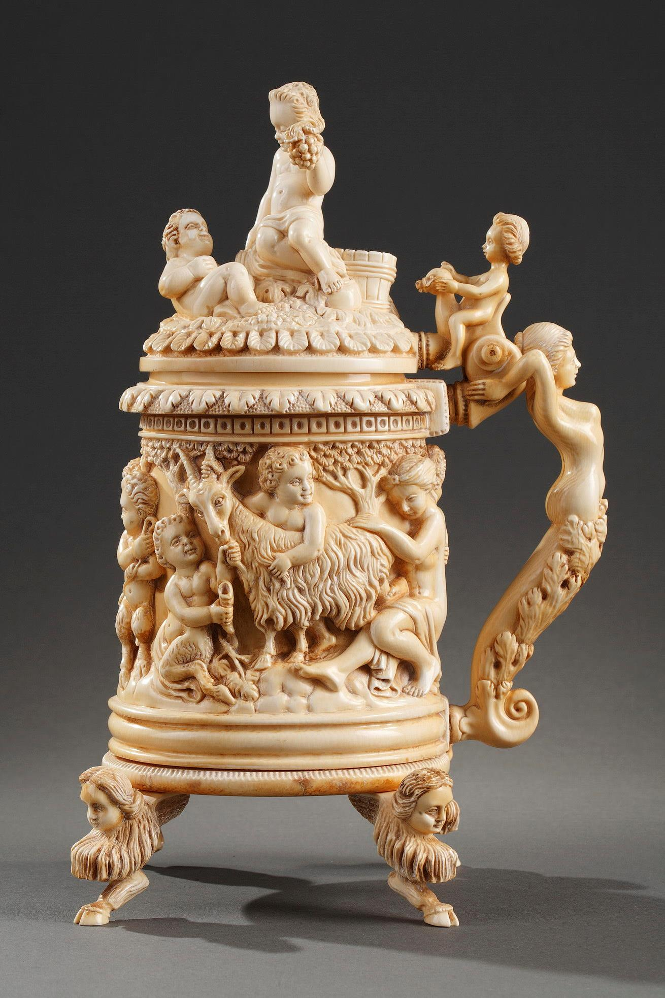 A 19th century GERMAN CARVED IVORY TANKARD