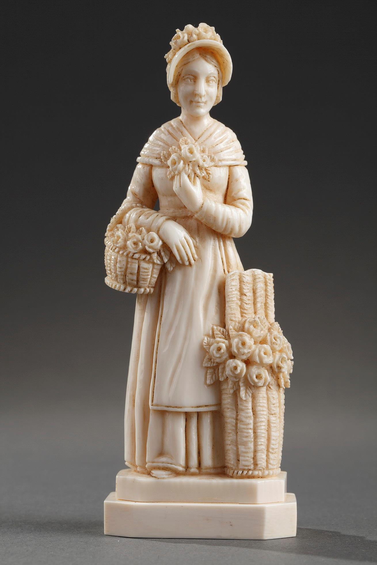 An ivory carved figure. Signed Migeon.