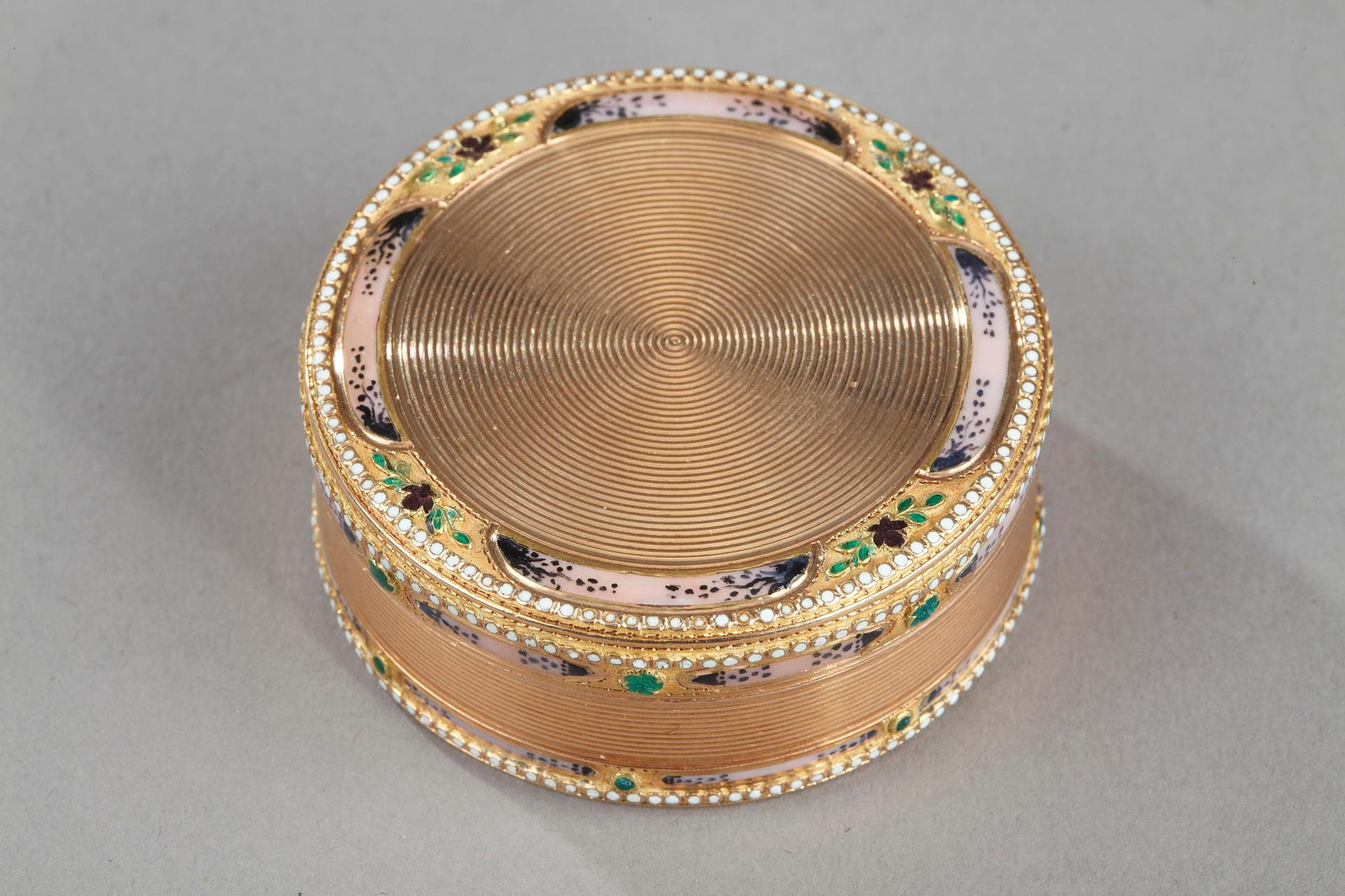 Gold and enamel 18th century circular box.