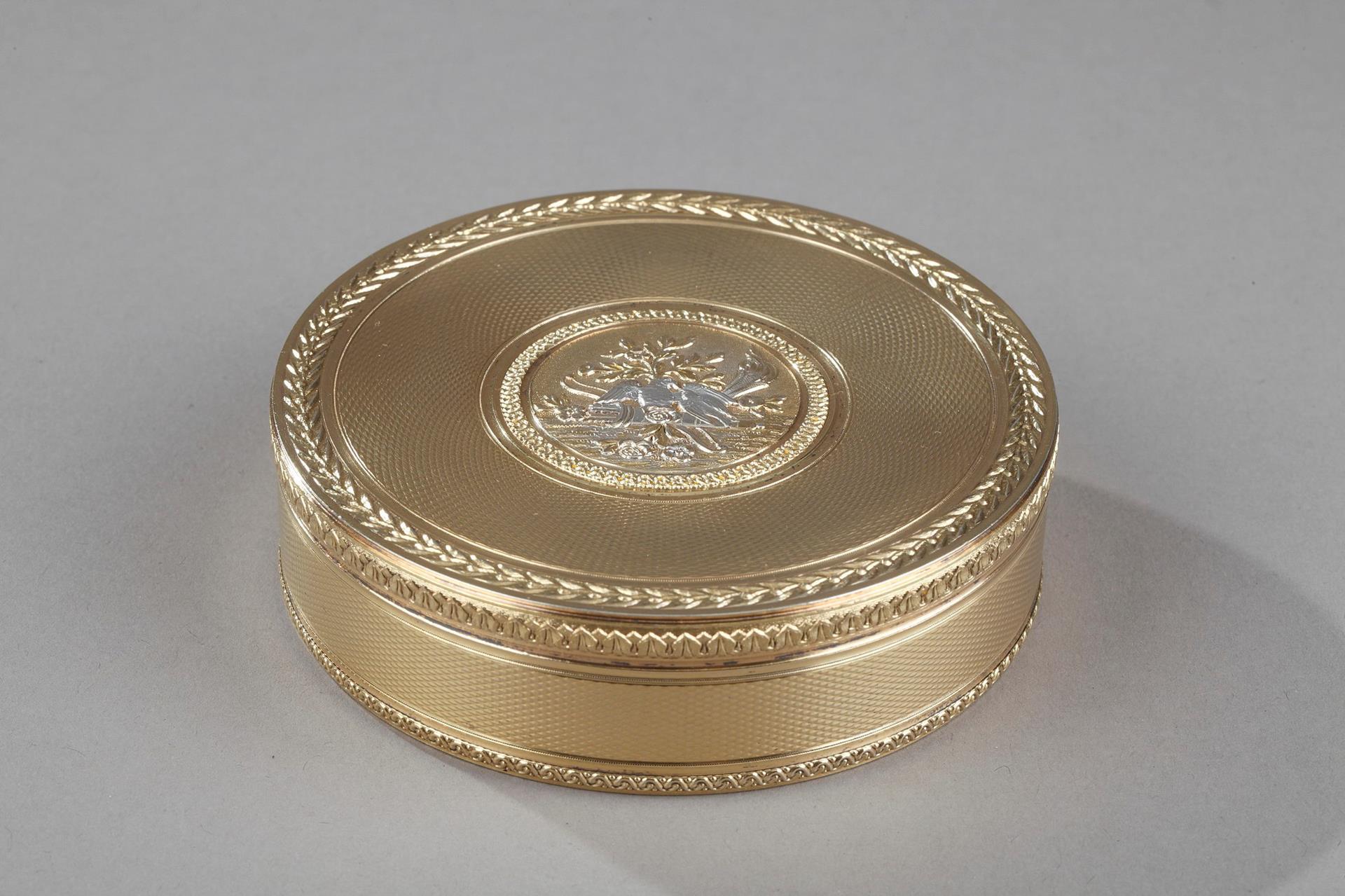 A CIRCULAR SILVER-GILT SNUFF BOX IN LOUIS XVI style. Boin Taburet