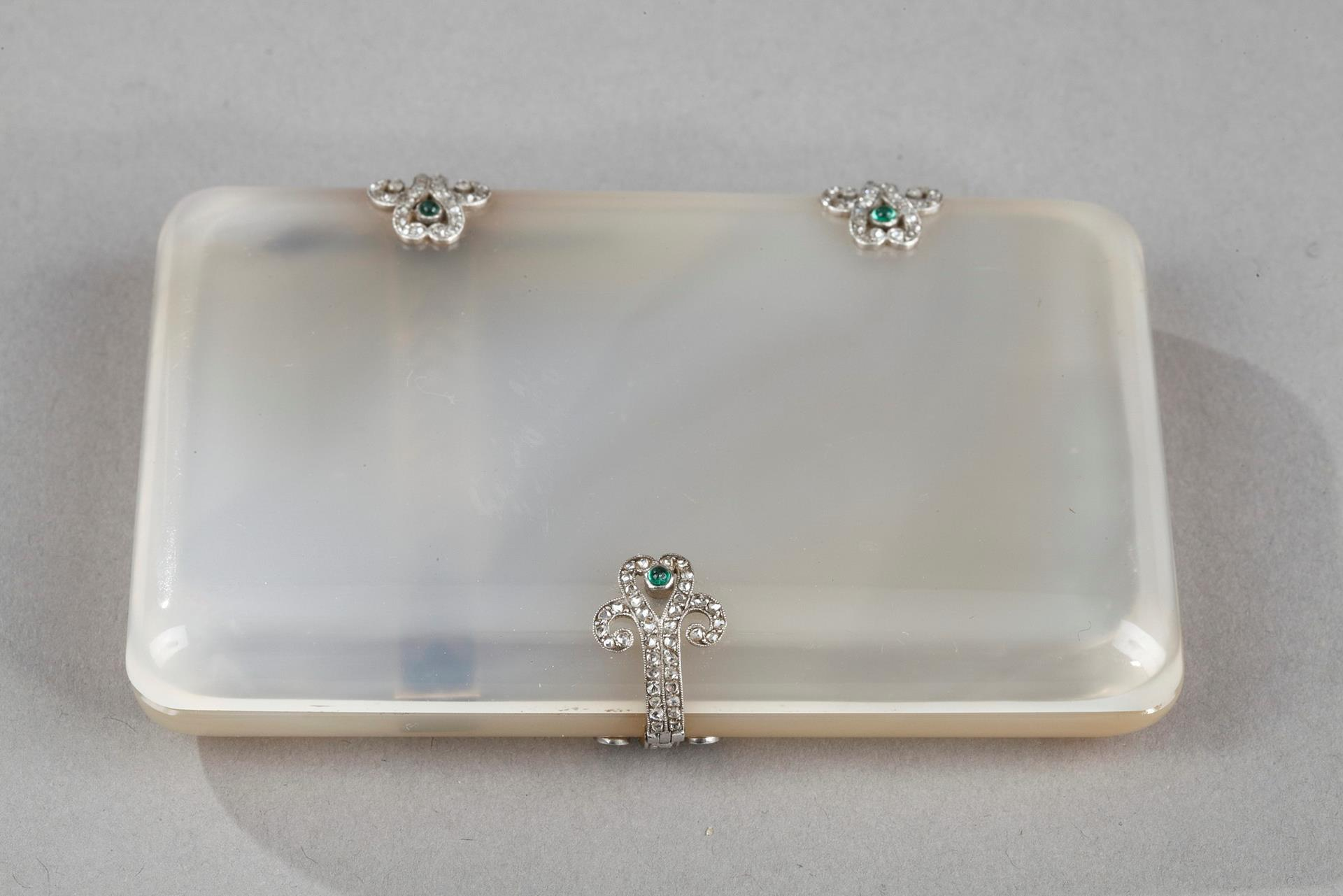 Art Deco case with agate, gold, diamonds and emeralds.