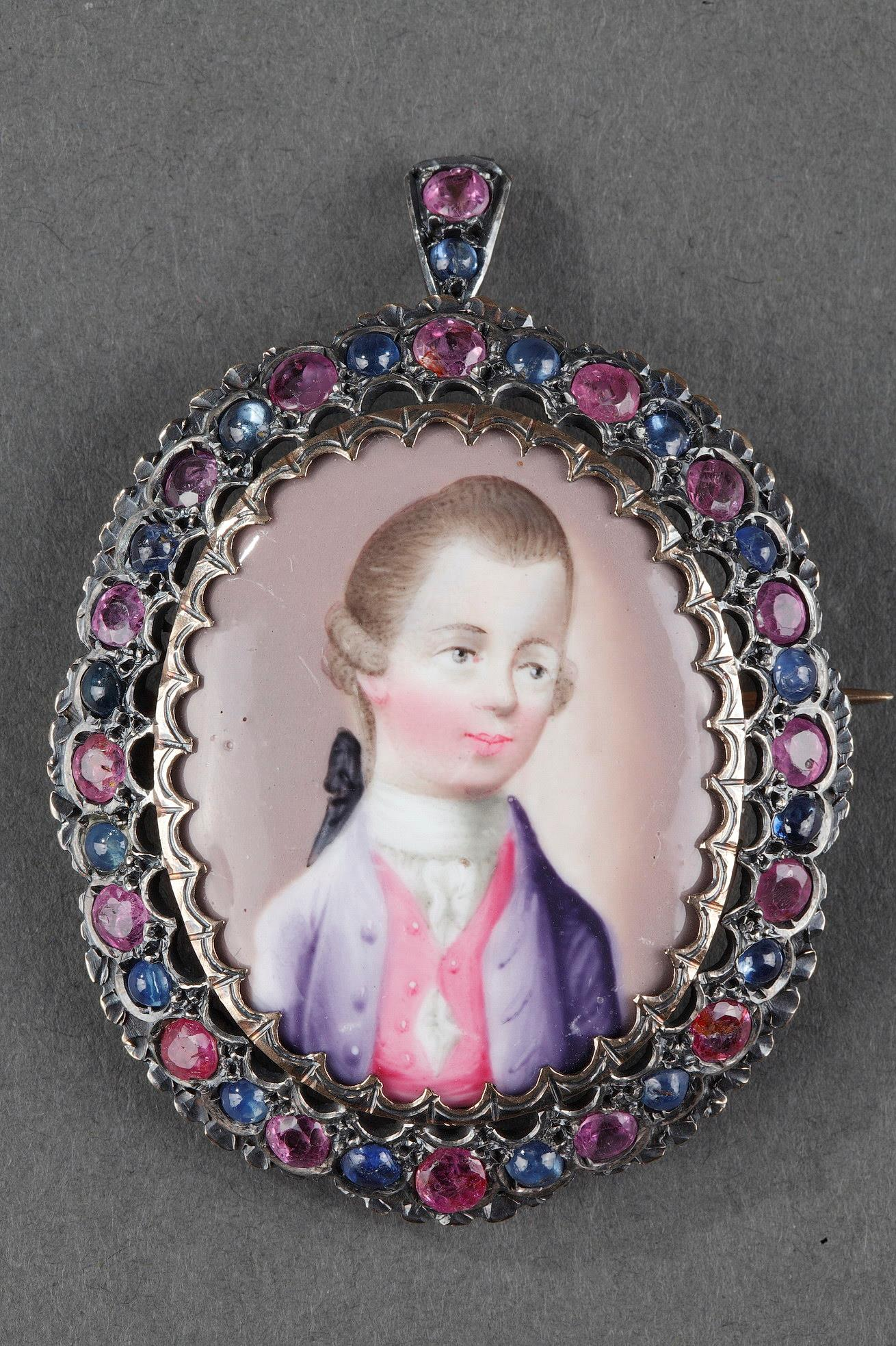 A 18th century gold pendant with miniature, sapphires and rubies.