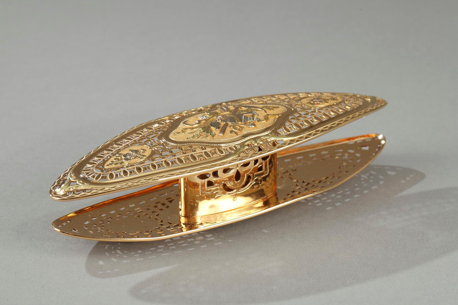 A Louis XV gold knotting shuttle.