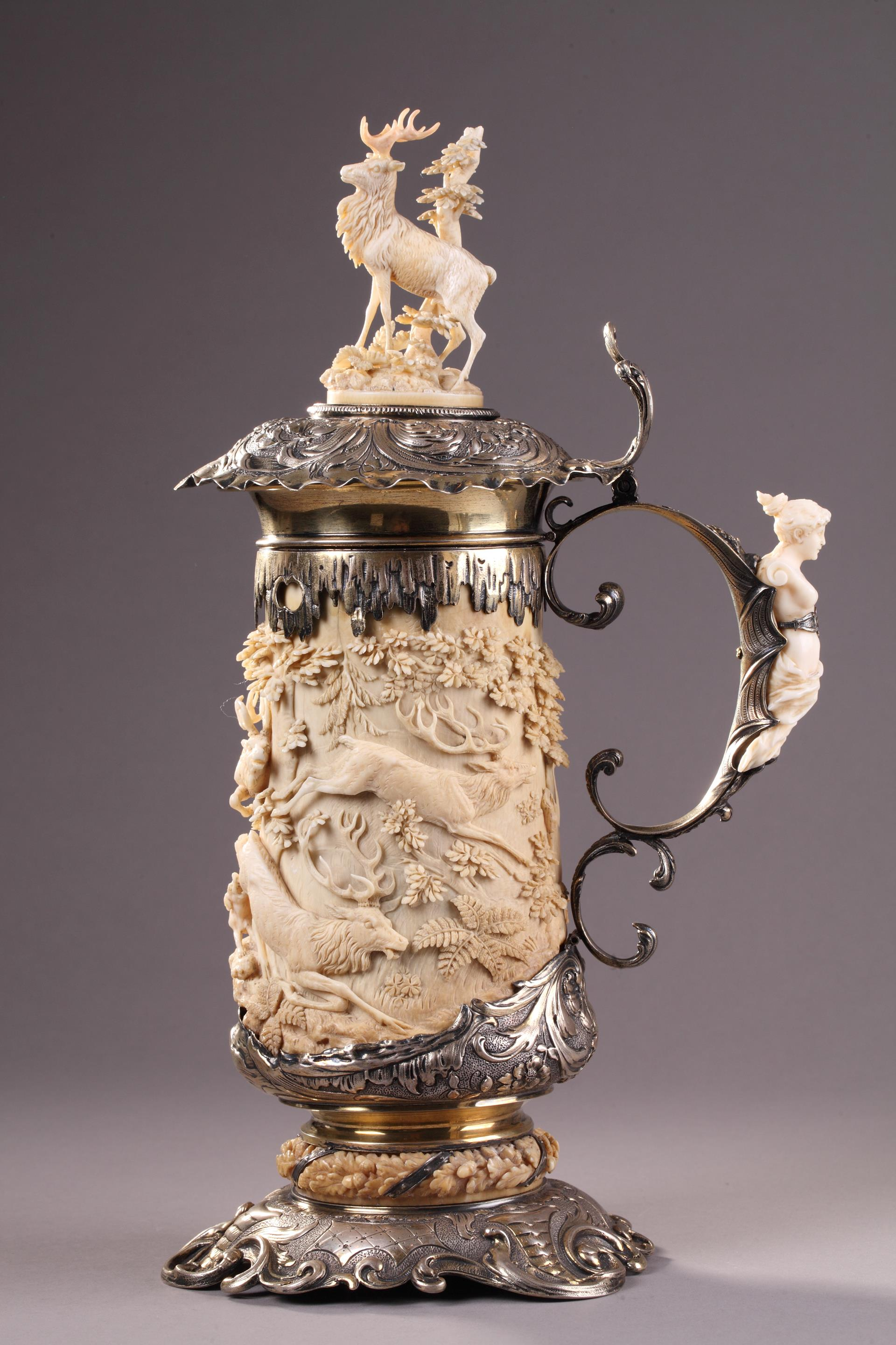 A SILVER MOUNTED RELIEF CARVED IVORY TANKARD.<br/> 18 TH GERMAN WORK.