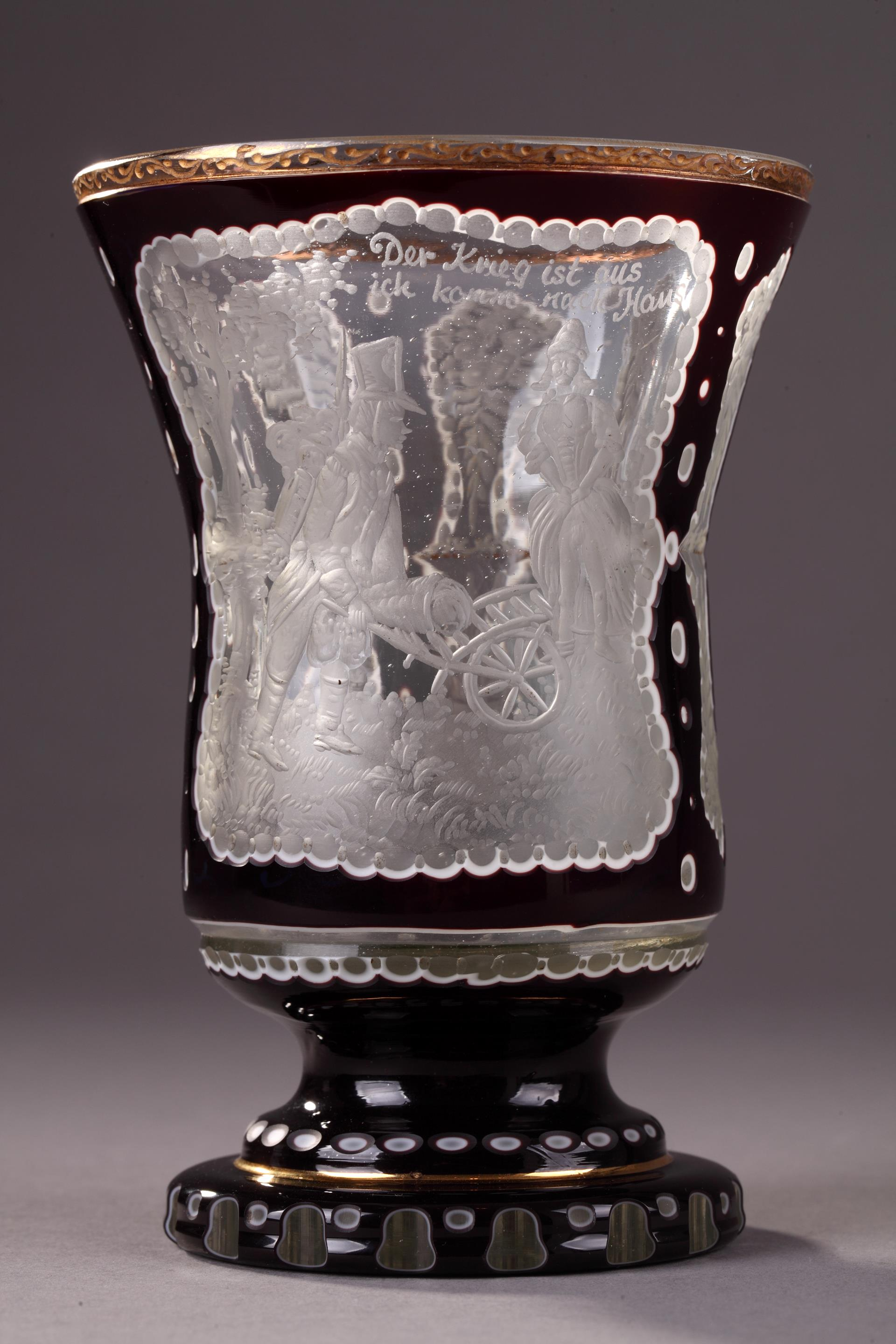 A bohemian ruby-overlay beaker with erotic medallion.