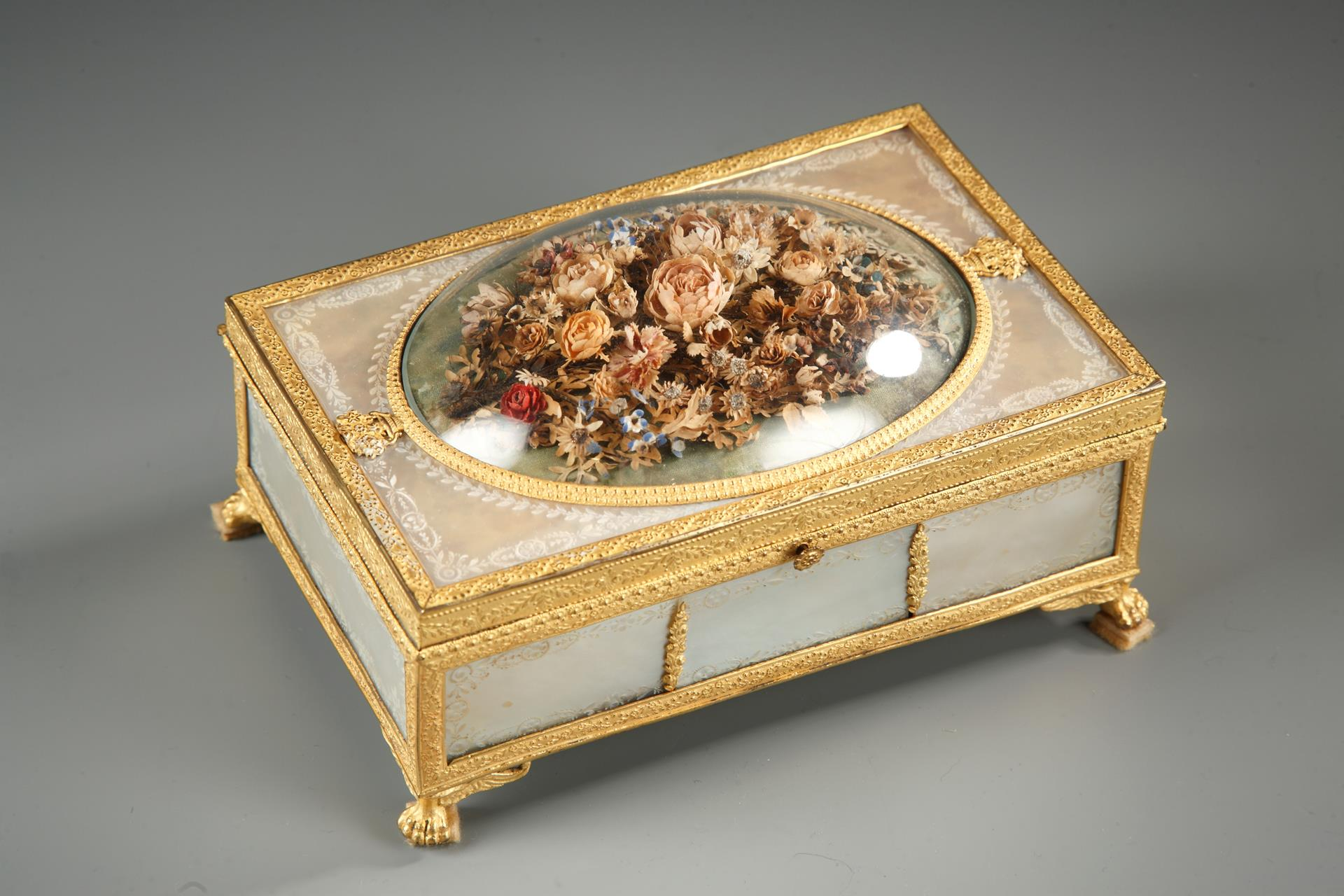 CHARLES X GILT BRONZE AND MOTHER-OF-PEARL BOX WITH FLOWERS.