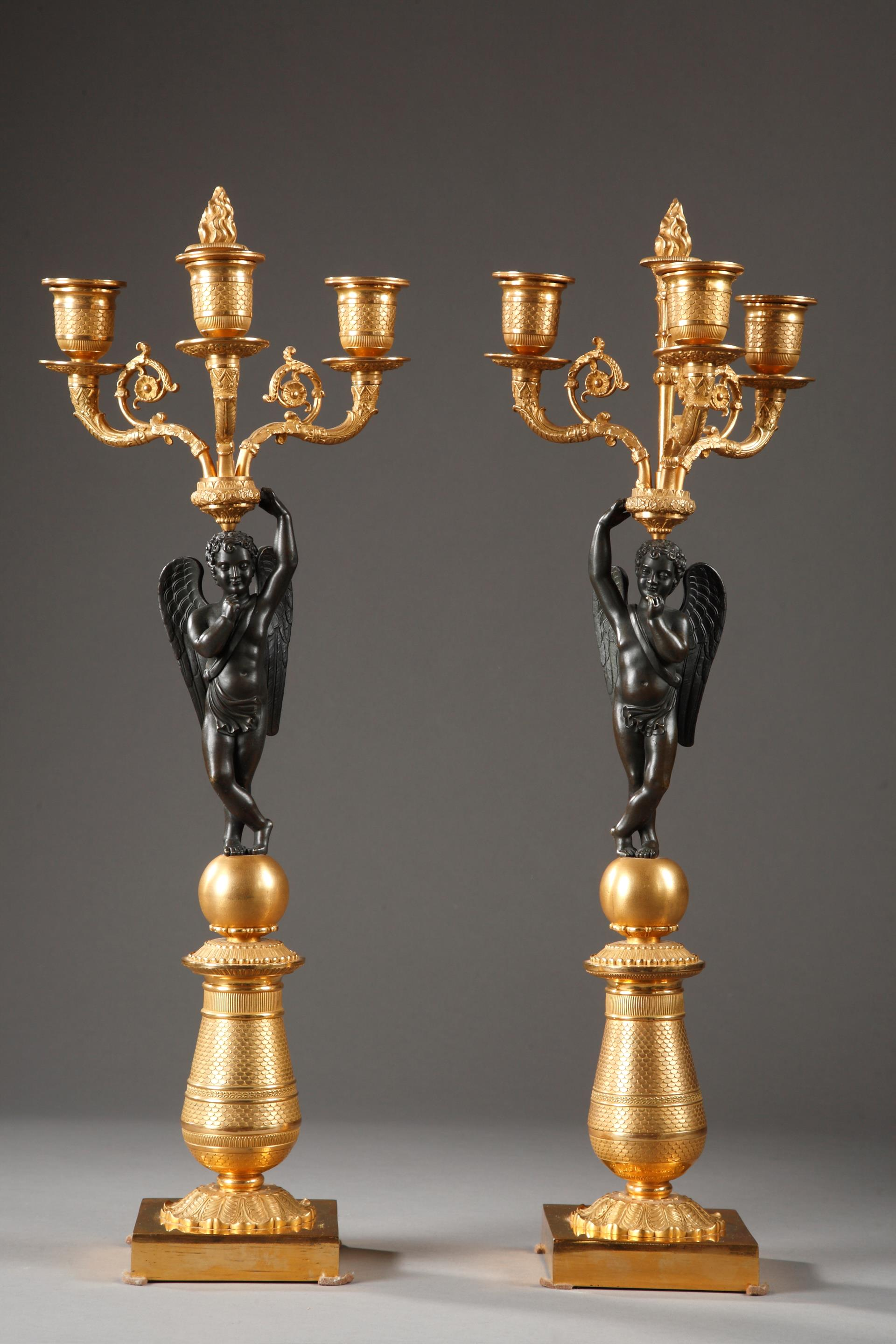 PAIR OF GILDED AND PATINATED BRONZE CANDELABRAS.<br/>